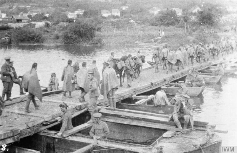 Troops of 'D'' Company, 1st Battalion, The Cameronians (Scottish Rifles) crossing a pontoon bridge over the Marne at La Ferte-sous-Jouarre, 10 September 1914. Imperial War Museum image Q51493