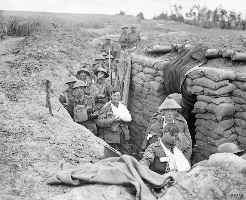 Action of Outtersteene Ridge. Wounded of the 27th Infantry Brigade, 9th (Scottish) Division, at a regimental aid post near Meteren following the formation's successful attack on Outtersteene Ridge, 18 August 1918. Imperial War Museum image Q6953