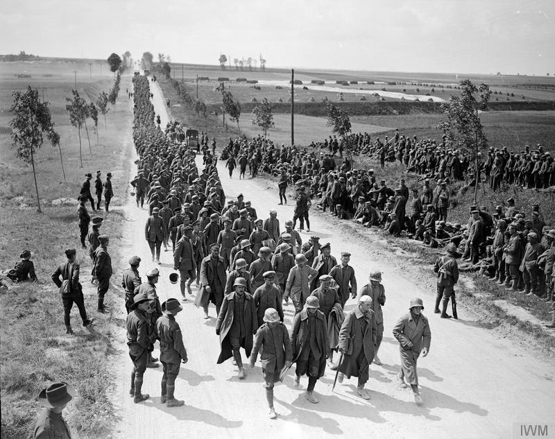 Battle of Amiens. German prisoners arriving at a temporary POW camp near Amiens, 9 August 1918. Imperial War Museum image Q9193