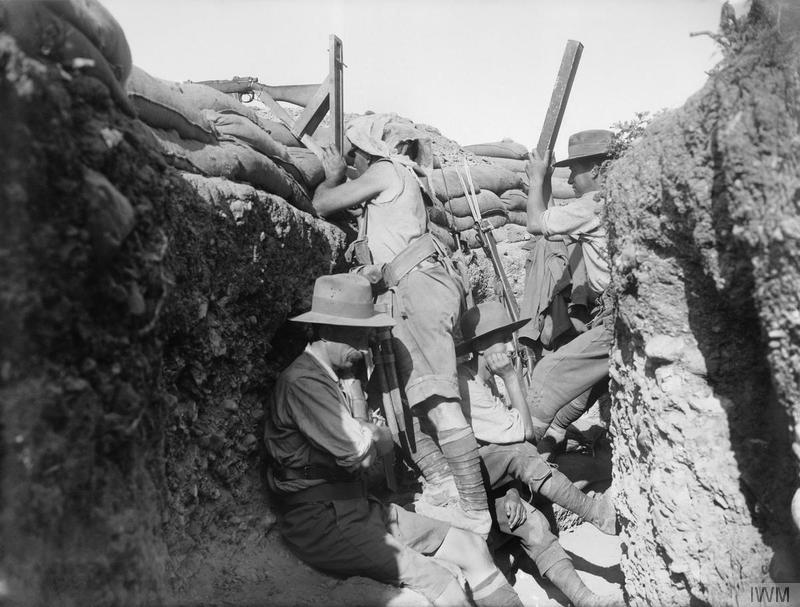Defence of the ANZAC. Scene in a trench during the period 28th April - 12th May, when the Marine and 1st Naval Brigades of the Royal Naval Division reinforced the Australian and New Zealand Army Corps in the area about what were later known as Quinn's and Courtney's Posts. The Marines brought a few periscopes with them, and the Australians improvised a supply from looking-glasses sent ashore from transports. Imperial War Museum image Q13247