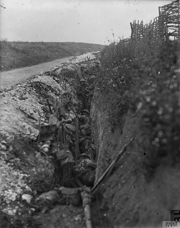 Imperial War Museum image Q62. British troops asleep in a support trench during the preliminary bombardment, previous to the attack on Beaumont Hamel, 1st July 1916. Note scaling ladders (duckboards) across trench.