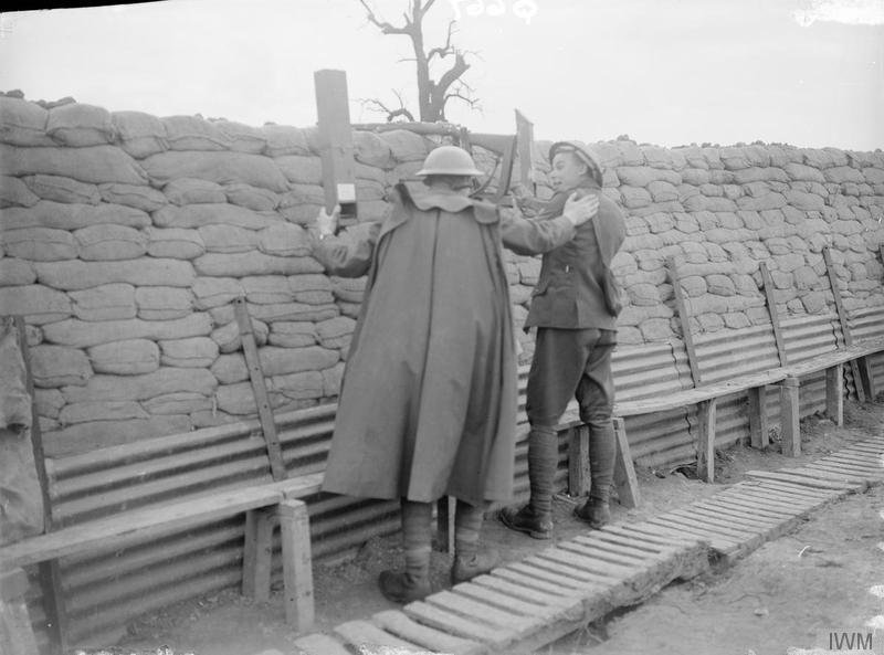 Imperial War Museum image Q667. New Zealand troops of the 9th (Wellington East Coast Rifles) Regiment using a periscope rifle and a trench periscope in a front line trench near Fleurbaix, June 1916. A well-constructed and dry trench in a quiet sector. It is odd in that it seems to be very broad (the rear parados can not be seen at all), and is typical of Flanders in that it is built up with sandbags rather than dug deep into wet ground.
