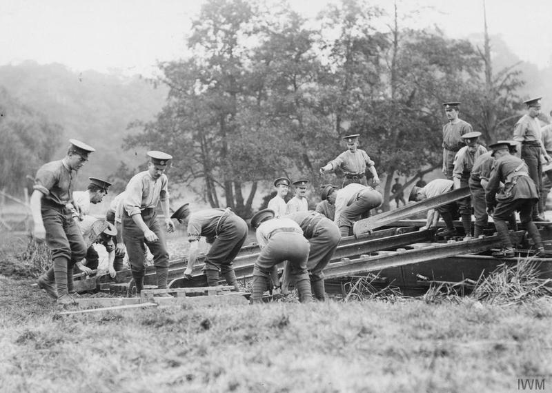 Troops of the 3/1st London Field Company, Royal Engineers constructing a pontoon bridge, 1915. IWM image Q53955