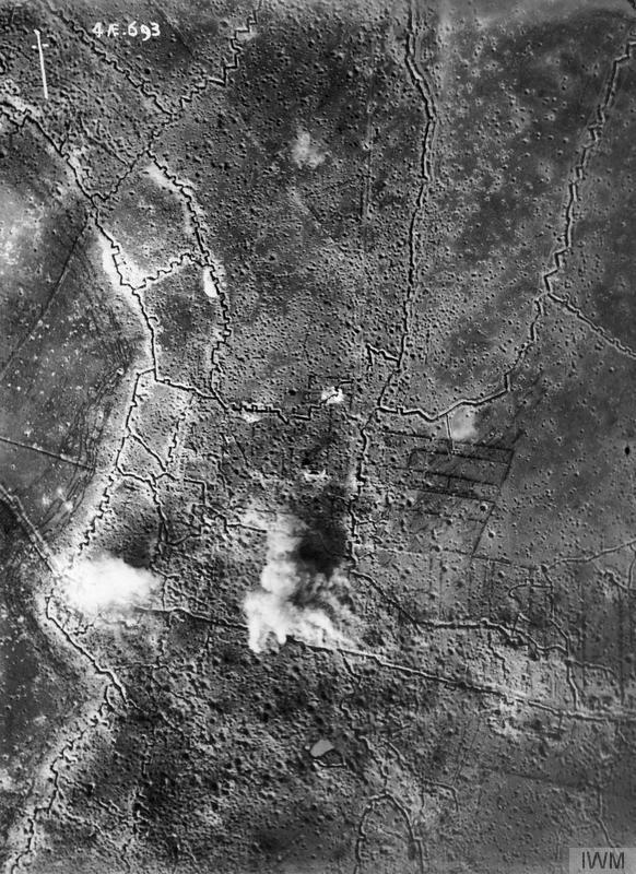 25 September 1916, Reserve Army front: vertical of Thiepval village, and German front-line and support trenches, while undergoing bombardment by British artillery prior to the Battle of Thiepval Ridge, Somme. IWM image HU91109