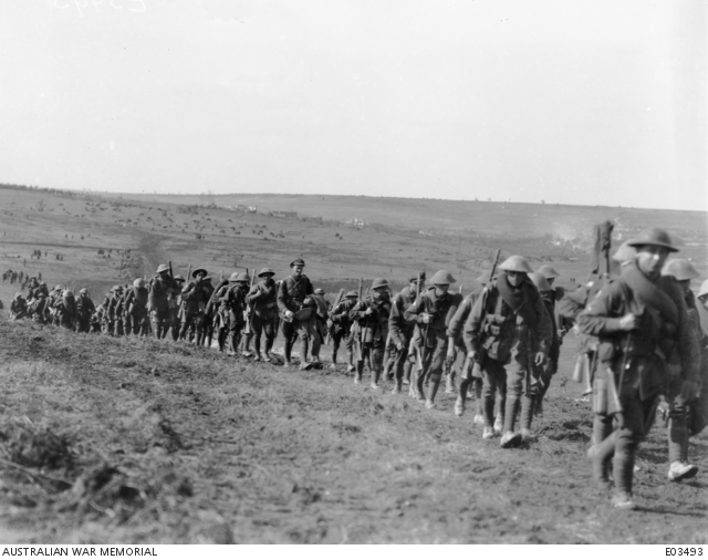 1 October 1918. The 28th Battalion marching past the village of Hargicourt, on their way to the front line trenches in the Hindenburg Line. The horses of various artillery units may be seen grazing on the hillsides. AWM image E03493, with thanks.