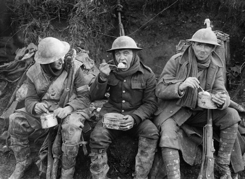 British soldiers eating hot rations in the Ancre Valley during the Battle of the Somme, October 1916. From the Ministry of Information First World War Official Collection at the Imperial War Museum, copyright image Q1580,with my thanks.