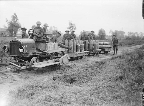 In the Third Battle of Ypres, which lasted from late July to November 1917.  Taking up shells by motor-driven light railway during the phase known as the Battle of Langemarck, near Elverdinghe, 19 August 1917. From the Ministry of Information First World War Official Collection at the Imperial War Museum, copyright image Q2661,with my thanks.