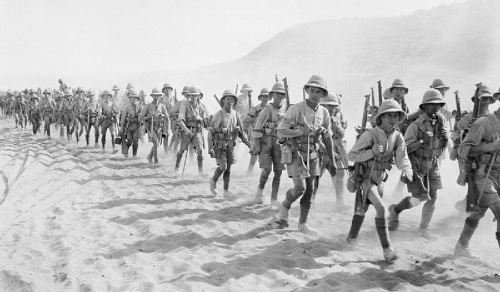 Men of the 1/5th Battalion of the Buffs (East Kent Regiment) passing over the Jebel Hamrin, December 1917. The photograph gives a good impression of infantry marching in desert conditions in Palestine. From the Ministry of Information First World War Official Collection at the Imperial War Museum, copyright image Q24374,with my thanks.