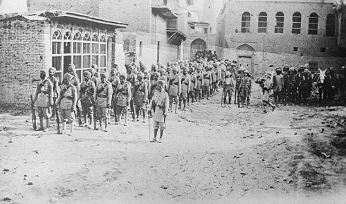 Indian infantry halted in the street of Kut-al-Amara in Mesopotamia, February 1917. From the Ministry of Information First World War Official Collection at the Imperial War Museum, copyright image Q25222,with my thanks.