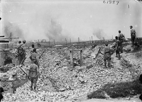 British  soldiers working in the ruins near Thelus (Vimy Ridge), watching shells bursting in the distance on 14th June 1917. From the Ministry of Information First World War Official Collection at the Imperial War Museum, copyright image Q2378,with my thanks.