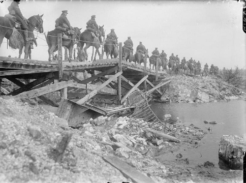 "British Cavalry crossing a wooden bridge over the River Somme at Brie, near Peronne, March 1917. They are part of the British pursuit of the German ""Retreat to the Hindenburg Line"", a strategic withdrawal from the Somme. The bridge was repaired on 18 March. From the Ministry of Information First World War Official Collection at the Imperial War Museum, copyright image Q1871,with my thanks."