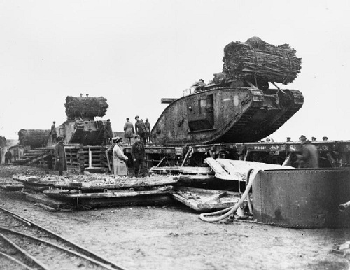 British  Mark IV Female Tanks being loaded aboard flat-bed railway trucks at Plateau Station in preparation for transportation to the forward area prior to the opening of the Battle of Cambrai. From the Railway Construction Engineers Collection at the Imperial War Museum, copyright image Q46932,with my thanks.