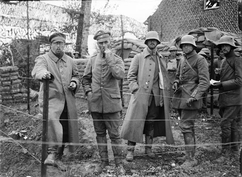 During the Third Ypres offensive, in the Battle of Broodseinde on 4 October 1917. A German Regimental Commander (in centre) with his Adjutant and Staff, captured at Poelcapelle by troops of the 11th (Northern) Division. Photo taken at St. Jean. From the Ministry of Information First World War Official Collection at the Imperial War Museum, copyright image Q2975,with my thanks.