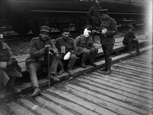 "Wounded Portuguese troops waiting for the Hospital Train; near Bethune on 10 April 1918. From the Ministry of Information First World War Official Collection at the Imperial War Museum, copyright image IWM Q438,with my thanks. The 2nd Portuguese Division was wiped out on the first day of the German ""Operation Georgette"", 9 April 1918."