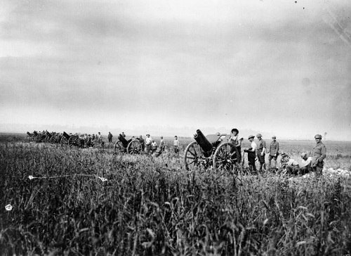 The 112th Howitzer Battery of the Australian Field Artillery in action in a wheat field at Villers-Bretonneux in the morning of the advance on 8 August 1918. The guns are 4.5 inch howitzers. From the Australian First World War Official Exchange Collection at the Imperial War Museum, copyright image IWM E(AUS)2927,with my thanks.