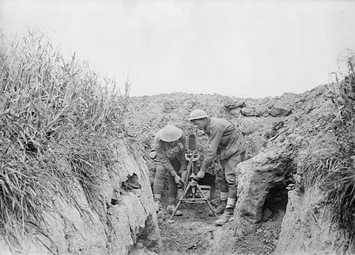 "A photograph taken on 10 July 1918. Two men of the 7th Australian Light Trench Mortar Battery operate a mortar established in a machine gun post on the new front line. From left to right: 1916 Lance Corporal A J Ellis and 2700 Private A Lawler. This position was part of a few hundred yards captured from the enemy in a silent daylight raid on 9 July by a party of the 27th Battalion. The location is just east of Villers-Bretonneux between the railway and the south side of the Amiens-St Quentin main road, alongside a position called 'The Orchard'. A fine example of the ""peaceful penetration"" tactics employed by the Aussies at this time. From the Australian First World War Official Exchange Collection at the Imperial War Museum, copyright image IWM E(AUS)2677,with my thanks."