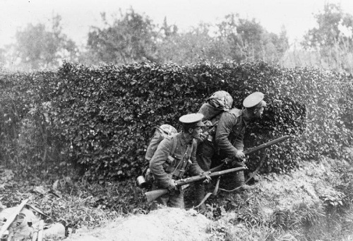 Two British soldiers take cover behind a hedge in Belgium on 13 October 1914. Image Q 53319 from the Sport & General Press Agency collection held by the Imperial War Museum, with my thanks.