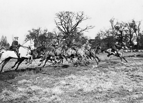 Officers of the 1st County of London Yeomanry (Middlesex, The Duke of Cambridge's Hussars) charge during training in Richmond Park on 10 February 1915. Image Q 53636 from the Sport & General Press Agency collection held by the Imperial War Museum, with my thanks.