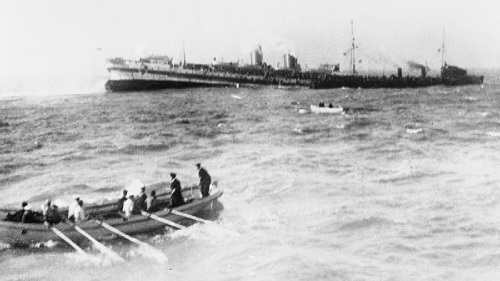 "British hospital ship ""Anglia"" sinking in the English Channel, 17 November 1915. From the First Wold War Agency Collection  at the Imperial War Museum, copyright image Q22867,with my thanks. ""Anglia"" hit a mine off Dover harbour at 12.30pm; 129 people lost their lives. Her wreck was one of the first 21 war graves designated by the British Government  under the 1986 Protection of Military Remains Act."