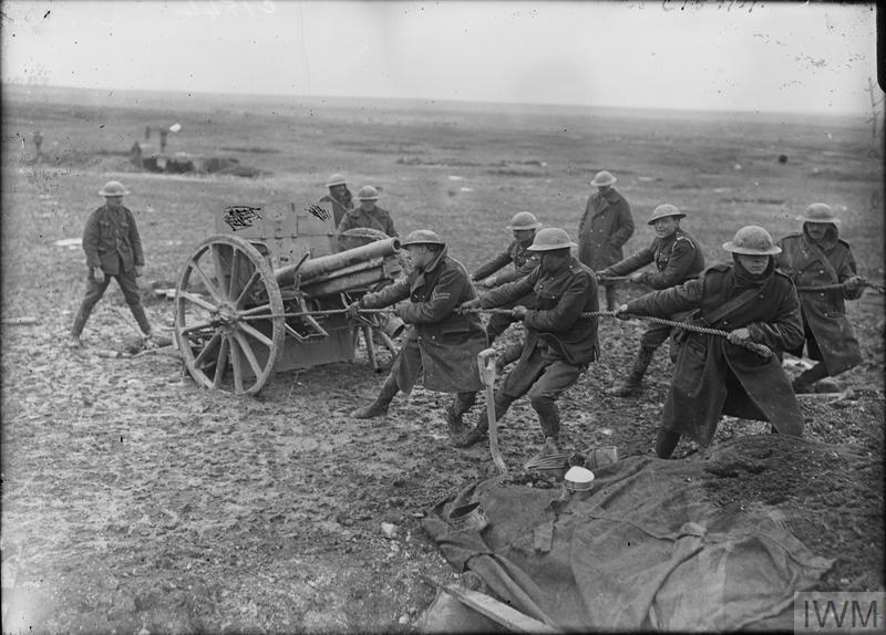 Imperial War Museum image Q 2035. Battle of the Scarpe. Gunners of the Royal Horse Artillery hauling a captured German field gun into position for use against the enemy on the Arras-Cambrai road, April 1917.